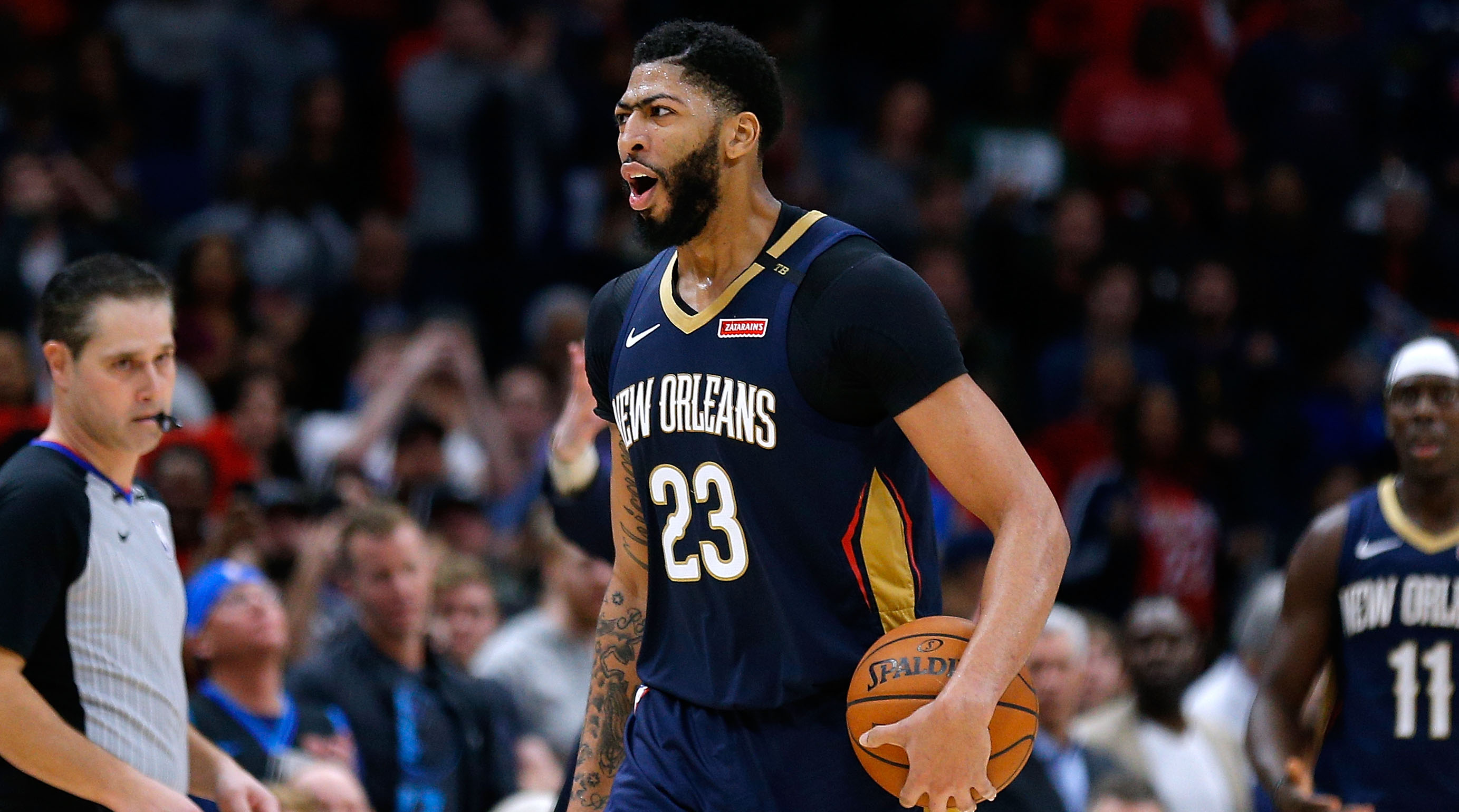 NEW ORLEANS, LOUISIANA - DECEMBER 28: Anthony Davis #23 of the New Orleans Pelicans reacts during a game against the Dallas Mavericks at the Smoothie King Center on December 28, 2018 in New Orleans, Louisiana. NOTE TO USER: User expressly acknowledges and agrees that, by downloading and or using this photograph, User is consenting to the terms and conditions of the Getty Images License Agreement.  (Photo by Jonathan Bachman/Getty Images)